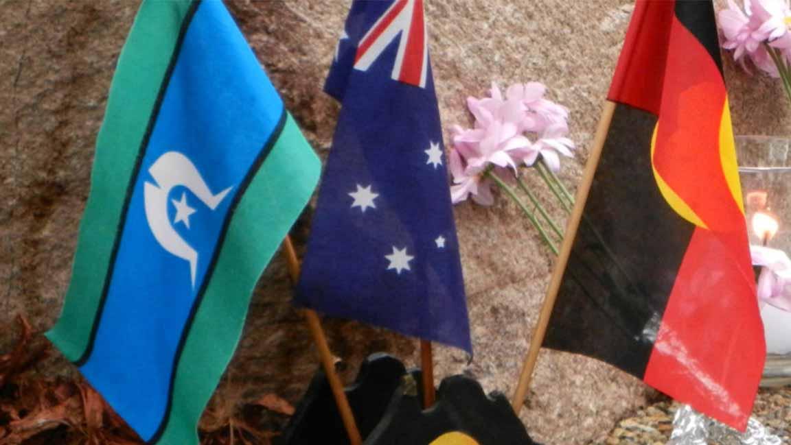 National flag flanked by (L-R) Torres Strait Isleander flag, Aboriginal flag